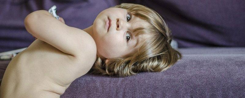 kid laying in sofa