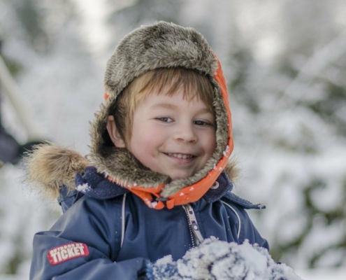 Cute boy smiling in the snow